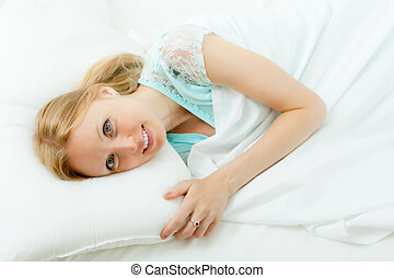 woman awaking in her bed