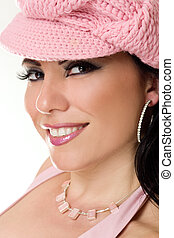 Pretty Woman - Beautiful woman smiling wearing pink hat...