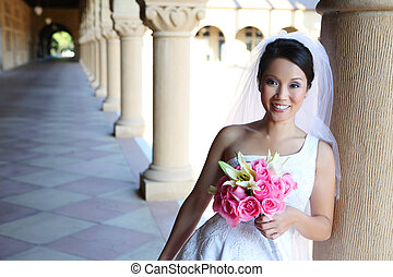 A beautiful asian woman bride on her wedding day (Natural Lighting)