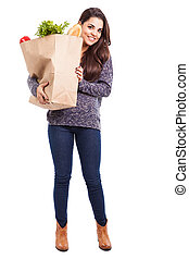 Pretty woman buying groceries