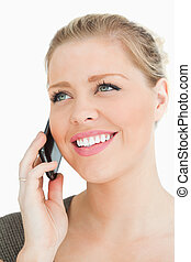 Pretty woman calling with her smartphone