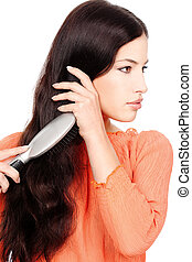 pretty woman combing hair