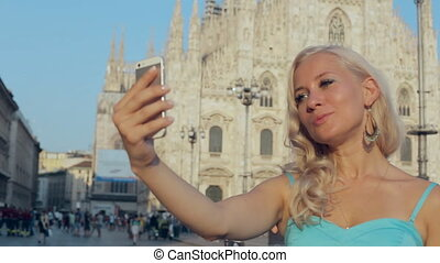 Pretty woman doing selfie on phone near Piazza Duomo