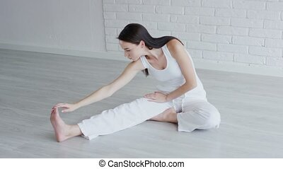 Pretty woman doing stretching exercise