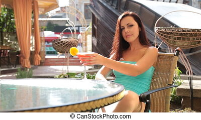 pretty woman drinking cocktail