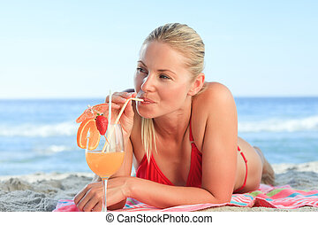 Pretty woman drinking her cocktail