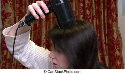 Pretty woman drying her hair