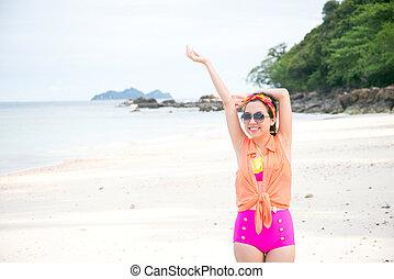 pretty woman enjoying summer sun by the sea