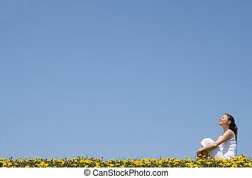 Pretty woman enjoying sunshine - Pretty young woman enjoying...