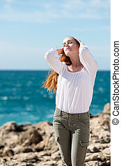 Pretty woman enjoying the sun on her face