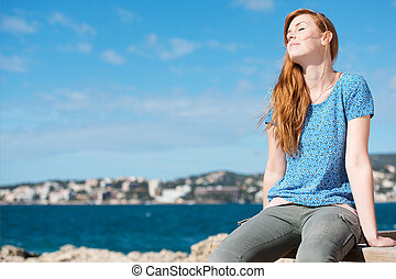Pretty woman enjoying the sunshine