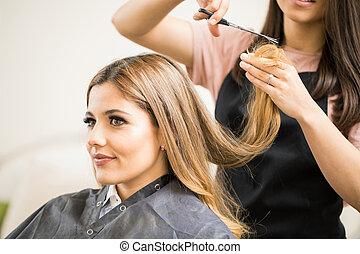 Pretty woman getting a haircut