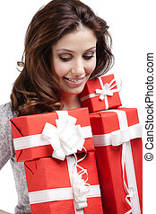 Pretty woman hands a number of presents