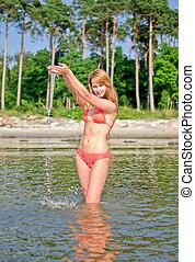 Pretty woman having fun in the sea