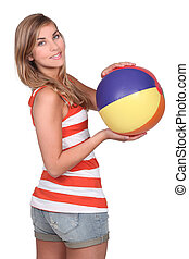 Pretty woman holding a ball