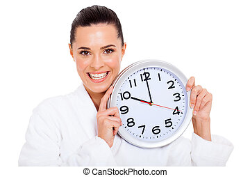 pretty woman holding a clock