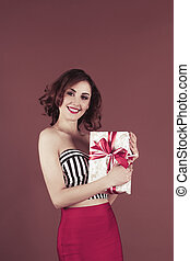 Pretty woman holding a gift