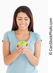 Pretty woman holding a green apple