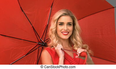 Pretty woman holding an umbrella