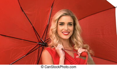 Pretty woman holding an umbrella on