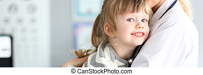 Pretty woman holding child in hands