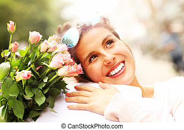 Pretty woman holding flowers and hugging a man