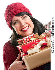 Happy, Attractive Woman Holds Holiday Gifts Isolated on a White Background.
