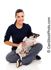 pretty woman holding pet dog - pretty young woman sitting on...