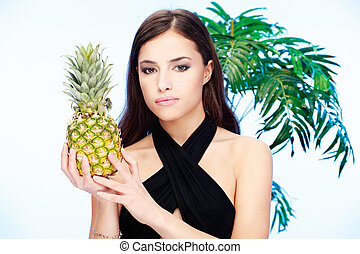 woman holding pineapple