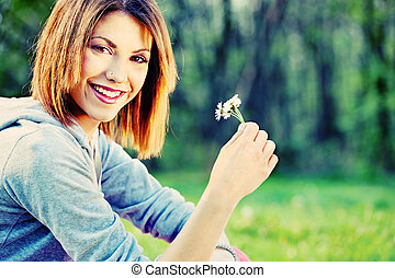 woman holding spring flower