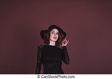 Pretty woman in a fashion dress