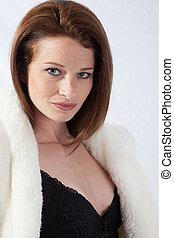 Pretty woman in a fur coat