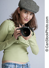 Pretty woman in a hat taking pictures