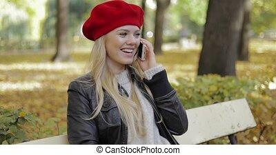 Pretty woman in beret speaking on phone - Pretty woman in...