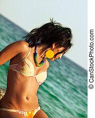 pretty woman in bikini at sea