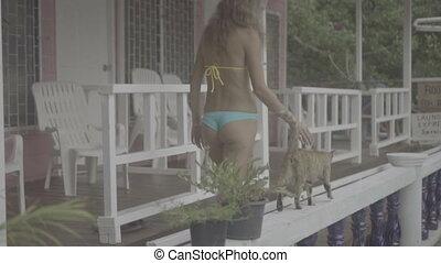 Pretty woman in bikini with cat
