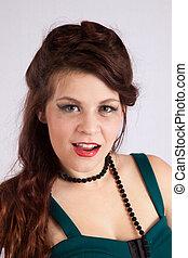 Pretty woman in black beads, happy
