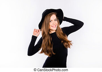 Pretty woman in black dress and hat