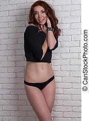 Pretty woman in black shirt. Studio shot