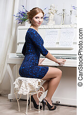 Pretty woman in blue and black dress