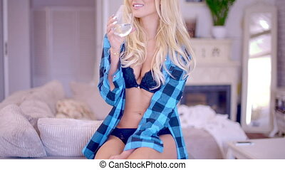 Pretty Woman in Blue Underwear Holding a Glass