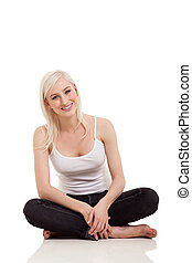 woman in casual clothes sitting on the floor