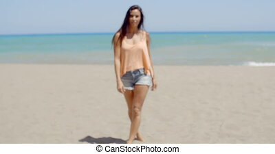 Pretty Woman in Casual Summer Wear at the Beach