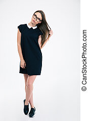 Pretty woman in dress and glasses
