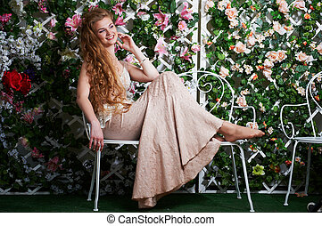 Pretty woman in dress with flower