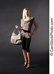 woman in fashion with handbag