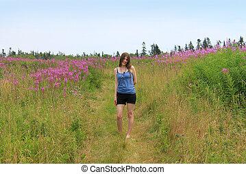 Pretty woman in field of lupins