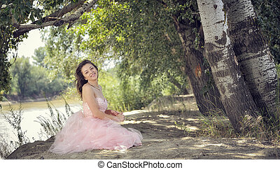 Pretty woman in forest in spring time