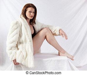Pretty woman in fur coat
