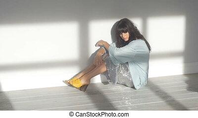 Pretty woman in glittering skirt